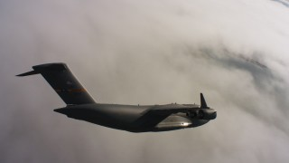 WAAF05_C003_0118D0 - 4K stock footage aerial video of a Boeing C-17 over clouds in Northern California