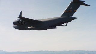 WAAF05_C017_01183V - 4K stock footage aerial video of a Boeing C-17 flying with cargo door open in Northern California