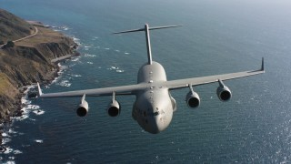 WAAF05_C037_0118FD - 4K stock footage aerial video of a Boeing C-17 flying along the coast in Northern California
