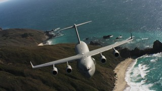 WAAF05_C040_0118VW - 4K stock footage aerial video of a Boeing C-17 following the coastline of Northern California