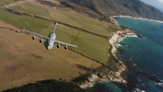 WAAF05_C041_0118CP - 4K stock footage aerial video tilt from fields to reveal a Boeing C-17 on the coast of Northern California