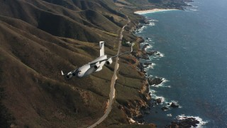 WAAF05_C044_0118LQ - 4K stock footage aerial video of a Boeing C-17 following the coast and flying out of frame, Northern California