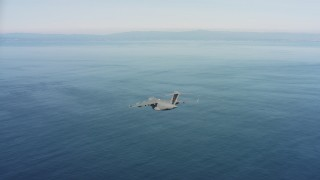 WAAF05_C048_0118M5 - 4K stock footage aerial video of a Boeing C-17 flying over the ocean in Northern California