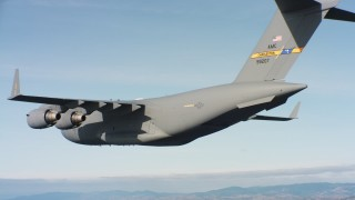WAAF05_C058_0118SP - 4K stock footage aerial video of a Boeing C-17 with cargo doors opening in flight over Northern California
