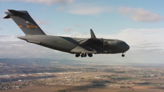 WAAF05_C076_0118DH - 4K stock footage aerial video of a Boeing C-17 near Travis Air Force Base with landing gear down, Northern California