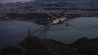 WAAF06_C085_0119X1_S000 - 4K stock footage aerial video of a Lockheed Martin C-130J flying over the Marin Hills at sunset near San Francisco, California