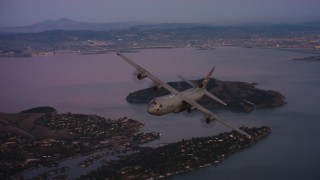 WAAF06_C085_0119X1_S001 - 4K stock footage aerial video of a Lockheed Martin C-130J over Richardson Bay at sunset in Northern California