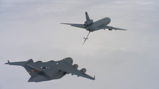 WAAF07_C033_0119VP - 4K stock footage aerial video of a McDonnell Douglas KC-10 refueling a Boeing C-17 over Northern California