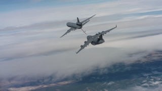 WAAF07_C040_0119WE - 4K stock footage aerial video of following a McDonnell Douglas KC-10 refueling a Boeing C-17, Northern California