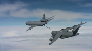 WAAF07_C040_0119WE_S000 - 4K stock footage aerial video of a McDonnell Douglas KC-10 finished refueling a Boeing C-17 in Norther California