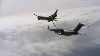 WAAF07_C042_0119DR - 4K stock footage aerial video of a view of a McDonnell Douglas KC-10 refueling a Boeing C-17 over Northern California