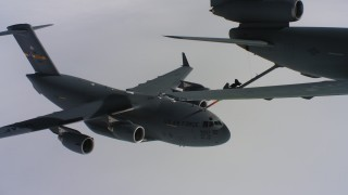 WAAF07_C049_0119K9 - 4K aerial stock footage video a McDonnell Douglas KC-10 fueling a Boeing C-17 over Northern California