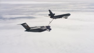 WAAF07_C050_0119C5 - 4K stock footage aerial video of a McDonnell Douglas KC-10 fueling a Boeing C-17 in flight over Northern California