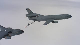 WAAF07_C060_01199M - 4K stock footage aerial video of a Boeing C-17 closing on a McDonnell Douglas KC-10 over Northern California