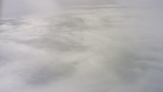 WAAF07_C074_01192B - 4K stock footage aerial video of a layer of clouds over Northern California