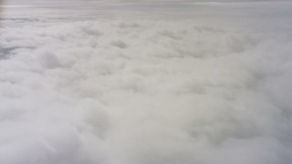 WAAF07_C077_01191U - 4K stock footage aerial video of flying over a layer of clouds over Northern California