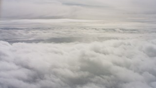 WAAF07_C078_01193F - 4K stock footage aerial video of flying by and descending toward a cloud layer in Northern California