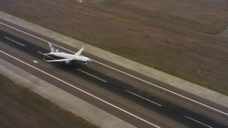 WAAF08_C002_01193P - 4K stock footage aerial video of a Boeing C-32 lifting off from Travis Air Force Base, California