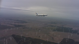 WAAF08_C008_0119F0 - 4K stock footage aerial video of tracking a Boeing C-32 over windmills in Northern California