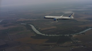 WAAF08_C011_011950 - 4K stock footage aerial video approach and fly over a Boeing C-32 in flight over Northern California