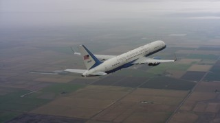 WAAF08_C016_0119WF - 4K stock footage aerial video of flying around the tail of a Boeing C-32 over farms in Northern California