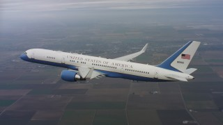 WAAF08_C017_0119R2 - 4K stock footage aerial video of a Boeing C-32 flying high above farmland in Northern California