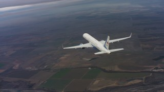 WAAF08_C020_0119PV - 4K stock footage aerial video of flying around the tail of a Boeing C-32 above farm fields in Northern California