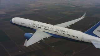 WAAF08_C024_0119EQ_S001 - 4K stock footage aerial video of a Boeing C-32 in the air above farmland in Northern California