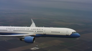WAAF08_C025_0119Q7 - 4K stock footage aerial video of a Boeing C-32 in flight over farm fields of Northern California