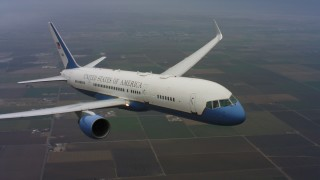WAAF08_C025_0119Q7_S000 - 4K stock footage aerial video of a Boeing C-32 in flight above farms in Northern California