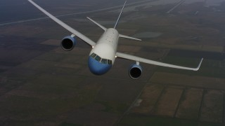 WAAF08_C027_01196C - 4K stock footage aerial video of a reverse view of a Boeing C-32 above farm fields in Northern California