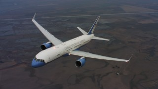 WAAF08_C028_0119NR - 4K stock footage aerial video a reverse view of a Boeing C-32 flying over farms and marshes in Northern California