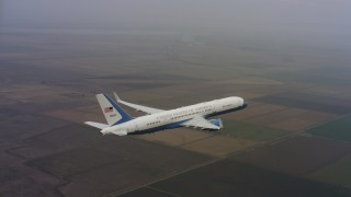 WAAF08_C032_0119FA - 4K stock footage aerial video circle around the tail of a Boeing C-32 over farmland in Northern California