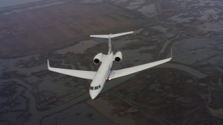 WAAF08_C036_01197J - 4K stock footage aerial video of a Gulfstream C-37A flying over rivers and marshes in Northern California