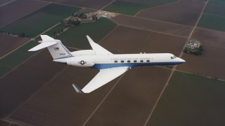 WAAF08_C042_0119R4 - 4K stock footage aerial video of a Gulfstream C-37A above farm fields in Northern California