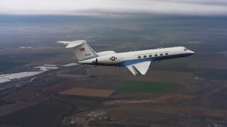 WAAF08_C052_0120MV - 4K stock footage aerial video of a Gulfstream C-37A above farms and marshes in Northern California