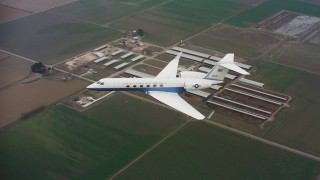 WAAF08_C060_0120A8 - 4K stock footage aerial video of Gulfstream C-37A over farms in Northern California