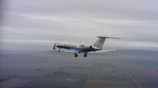 WAAF08_C063_01208H - 4K stock footage aerial video of a Gulfstream C-37A raising and lowering landing gear over Northern California