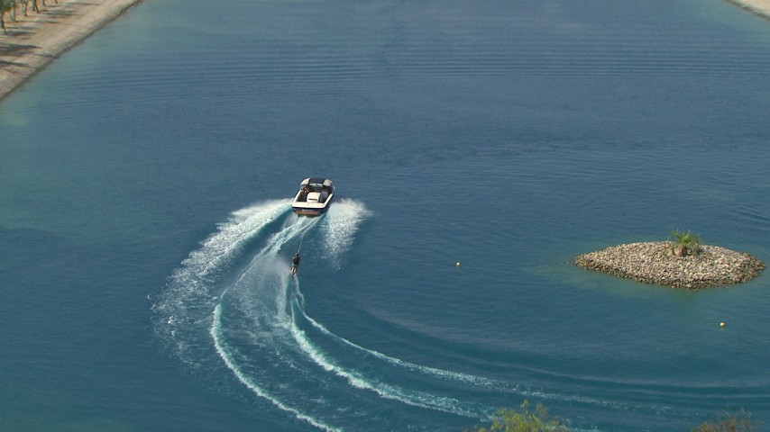 HD stock footage aerial video of a woman waterskiing behind a boat in a Central Valley lake, California Aerial Stock Footage | AF0001_000020