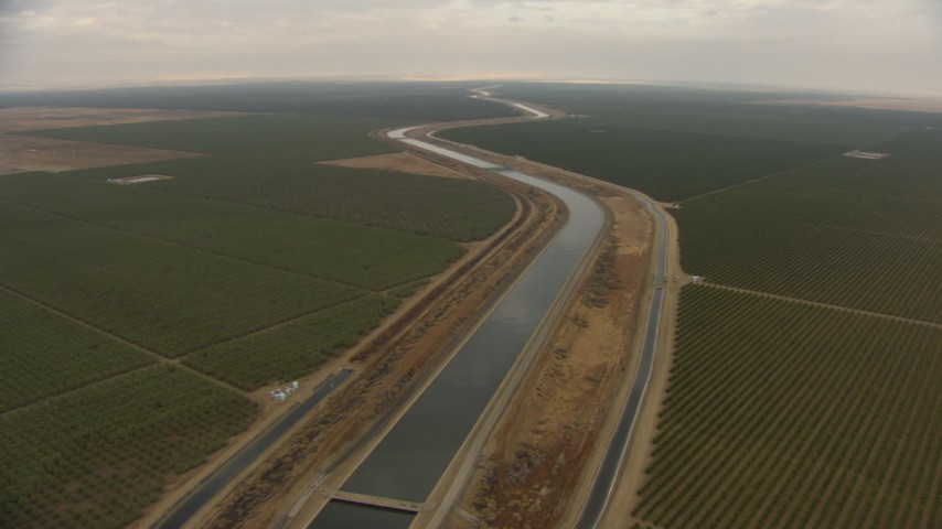 HD stock footage aerial video follow California Aqueduct, winding through farmland, Central Valley, California Aerial Stock Footage | AF0001_000031