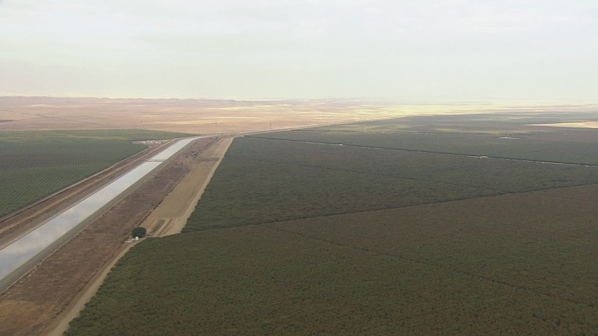 HD stock footage aerial video tilt from a bird's eye of the California Aqueduct to reveal farmland, Central Valley, California Aerial Stock Footage   AF0001_000036