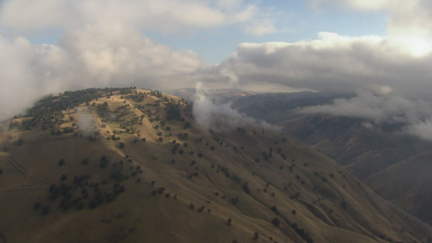 HD stock footage aerial video of approaching low clouds over mountains in the Tejon Pass, California Aerial Stock Footage | AF0001_000037