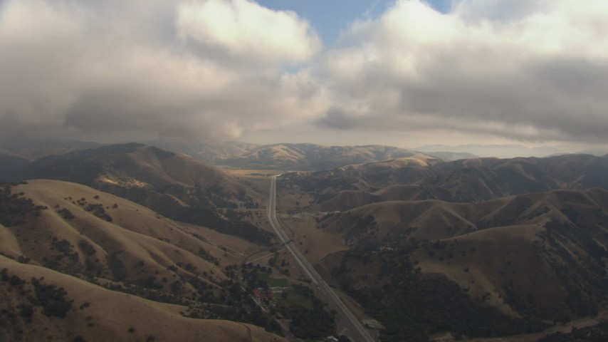 HD stock footage aerial video of flying under low clouds to follow Interstate 5 through Tejon Pass, California Aerial Stock Footage | AF0001_000040