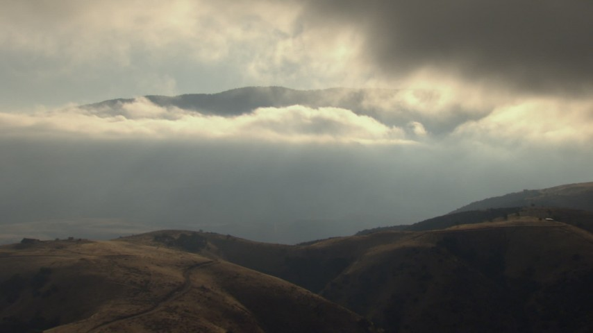 HD stock footage aerial video flyby low clouds and mountains, revealing Cuddy Canyon, Tejon Pass, California Aerial Stock Footage | AF0001_000043