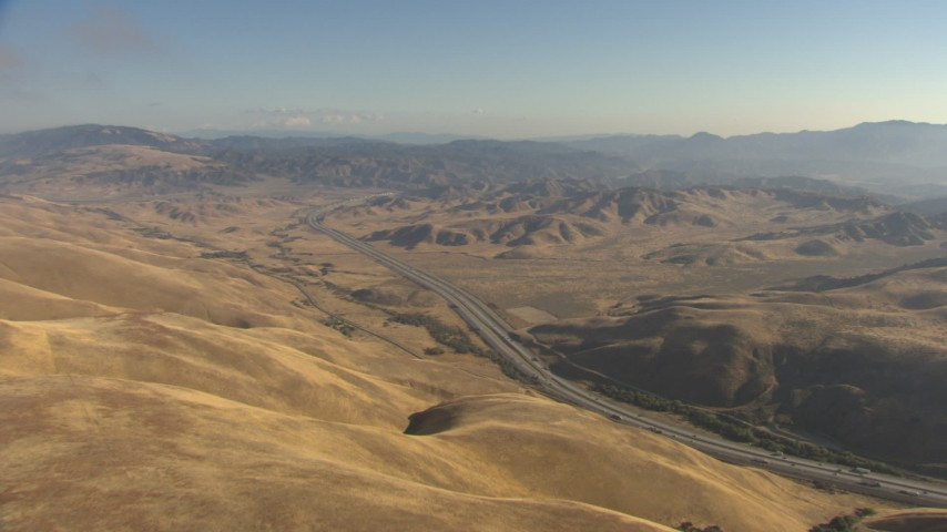 HD stock footage aerial video approach Interstate 5 winding around hills to mountains Tejon Pass, California Aerial Stock Footage | AF0001_000045