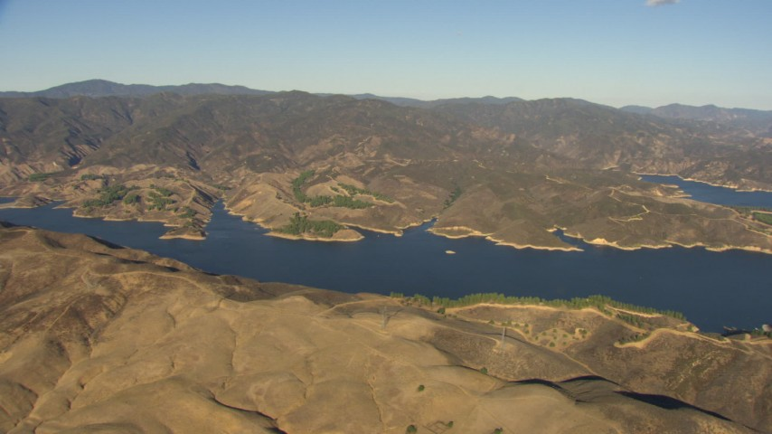 HD stock footage aerial video flyby Castaic Lake to reveal part of Castaic Dam, California Aerial Stock Footage | AF0001_000047