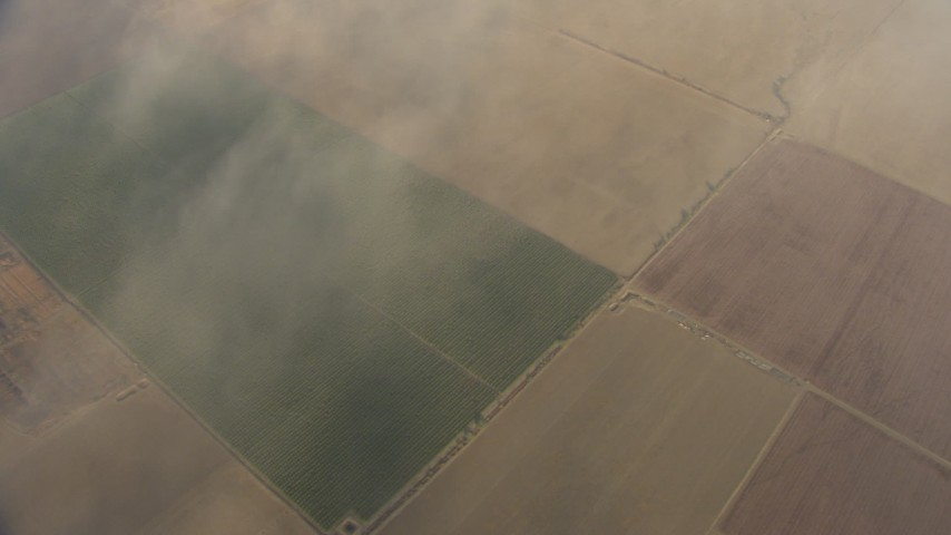 HD stock footage aerial video of a bird's eye view flying over farmland and hazy clouds, Central Valley, California Aerial Stock Footage | AF0001_000076