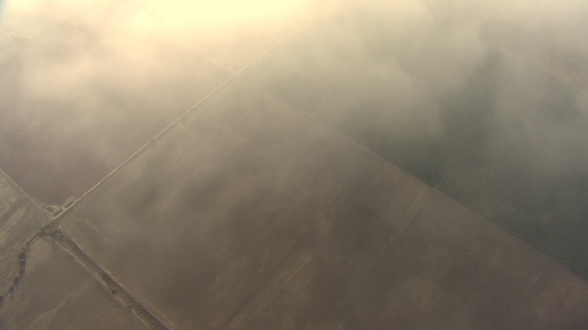 HD stock footage aerial video bird's eye view of farmland below hazy clouds, Central Valley, California Aerial Stock Footage   AF0001_000078