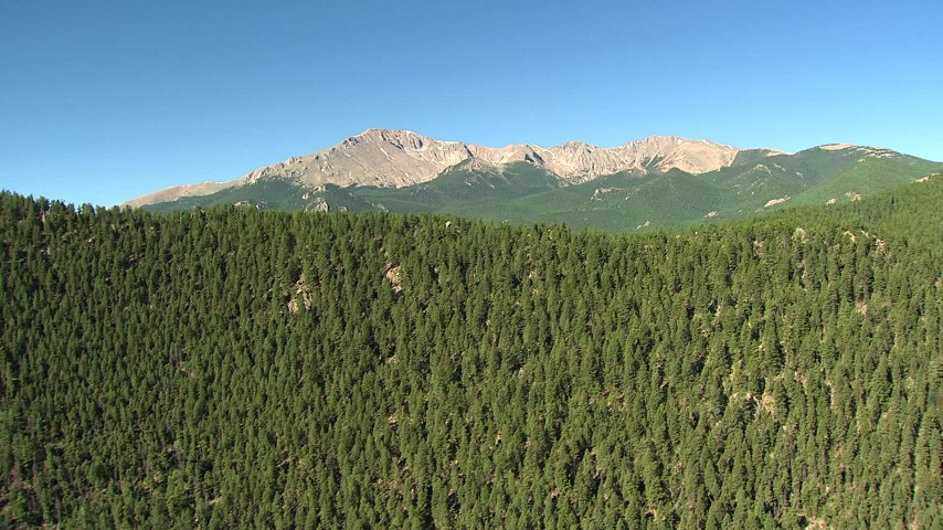 HD stock footage aerial video of ascending near a mountain ridge to reveal Pikes Peak, Colorado Aerial Stock Footage | AF0001_000083