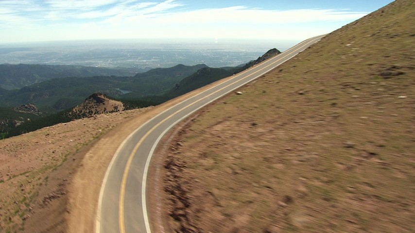 HD stock footage aerial video flyby a mountain road to reveal Pikes Peak, Rocky Mountains, Colorado Aerial Stock Footage | AF0001_000088